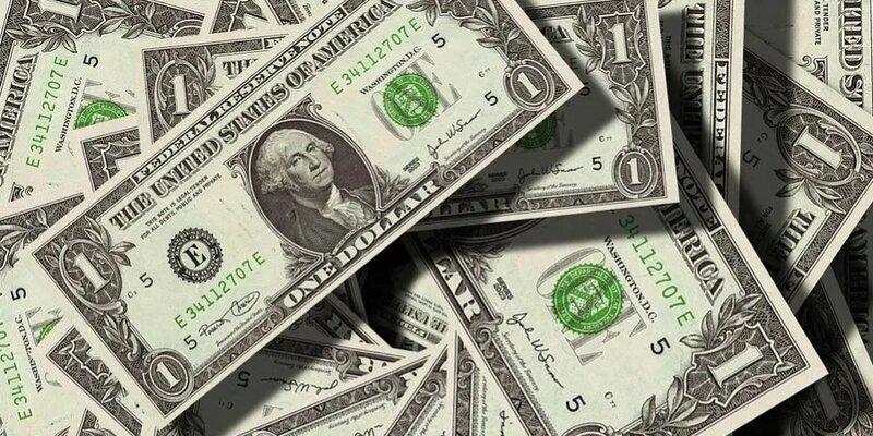 Средневзвешенный курс доллара вырос до 74,63 рубля